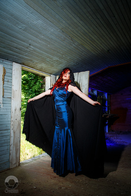 Miss Margaux Madness PinUp with cloak by The Wishmaster's Capes & Costumes shot in Tennessee